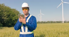Supervisor Using Digital Tablet Agricultural Landscape Windmill Technology Stock Footage