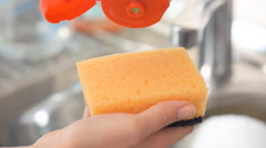 Sponge with dish washing liquid. - stock footage