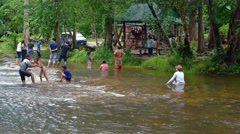Families bathing in the refreshing water of the river at Phnom Kulen Stock Footage