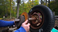 Focus on heavy handmade barbell in a forest open air gym. - stock footage