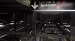 panning across sign for Uptown and The Bronx in subway station at 14th Street - stock footage