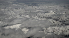 Aerial view through an airplane window, fly over snow Caucasian mountains Stock Footage