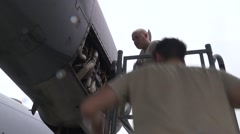 Aircraft Maintenance Squadron work on an engine on of a C-130 J Hercules - stock footage