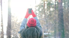 Girl make a selfi in winter in sunset Stock Footage