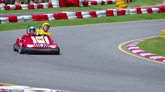 Tourists racing go carts at Phuket Kart - attraction in Kathu, Thailand Stock Footage