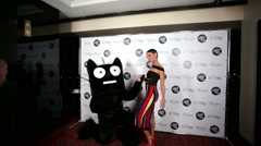 Marta the Cat singer pose with a man in a cat costume during photo session. - stock footage