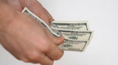 Close up view of man's hands count hundred dollar bills Stock Footage