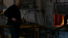 Glassworker in action in the Murano glassfactory - stock footage