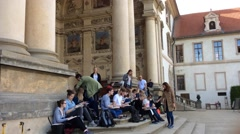 A Group of Students is Sitting and Painting on the Steps Stock Footage