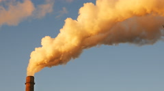 Factory plant smoke stack over blue sky background Arkistovideo