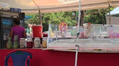 Woman working at a food stand at a fair Stock Footage