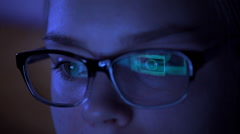 Woman in glasses surfing internet on tablet computer at night Stock Footage