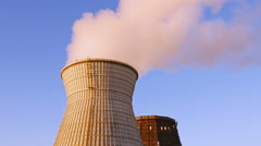 Water cooling tower stack smoke over blue sky Stock Footage