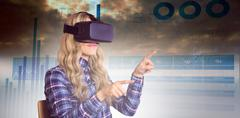 Composite image of pretty casual worker using oculus rift Kuvituskuvat