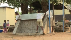 STUDENTS REMOVING SECURITY COVER FROM WATER TAPS - stock footage