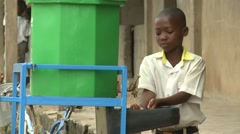 STUDENT WASHING HIS HANDS AT HANDWASHING STATION Stock Footage