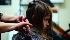 Barber cutting  long hair of a girl Stock Footage