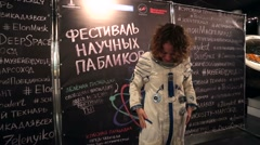 Young woman takes photo in a spacesuit. Stock Footage