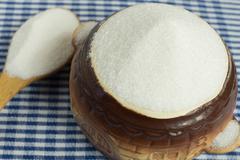 White sugar in a pot. - stock photo
