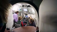"People navigate ""Soyuz TMA"" spaceship simulator. Stock Footage"