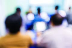 Blurred people in seminar room Stock Photos