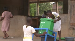 STUDENTS CLEAN GREEN BUCKET OF HANDWASHING STATION Stock Footage
