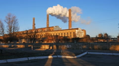 Factory plant smoke stack over blue sky background Stock Footage