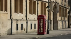 Red phone box in Oxford on a high street, Oxford, England, Europe Stock Footage