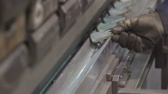 A worker arranging the small triangle metals Stock Footage