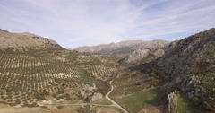 4K Aerial, Flight along mountains and olive plantations, Andalusia, Spain - stock footage