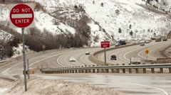 Trucks and cars drive on I-80 Stock Footage
