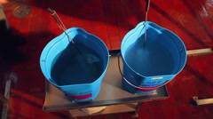 Two buckets with disinfectant. Worker takes cleaning brush from water in buckets Stock Footage