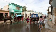 Cuba, Cardeans street scene with üeple and horse cart Stock Footage