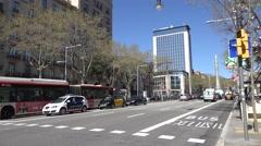 4K Public bus police car taxi wait line stop light large avenue Barcelona city  Stock Footage
