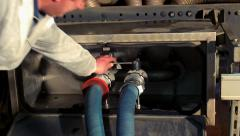 Technician open valve on truck. Milk tank. Dairy industry machinery - stock footage
