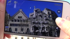 4K Woman take photo mobile phone Amatller building Casa Batllo Barcelona daytime Stock Footage