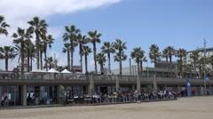 4K Famous Barceloneta promenade restaurant terrace sandy beach Barcelona daytime Stock Footage