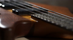 Electric Bass Guitar Rotate on a Dark Background Stock Footage