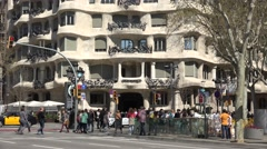 4K Crowd people visit Casa Mila La Pedrera building Barcelona landmark iconic  Stock Footage