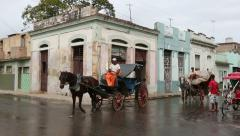 Cuba, Cardeans street scene with horse carts - stock footage