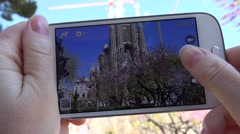 4K Woman take photo mobile phone Sagrada Familia Barcelona landmark day iconic Stock Footage