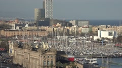 4K Pan right Port Vell Barceloneta landmark Barcelona old harbor yacht anchoring Stock Footage