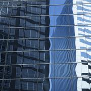 Abstract image of modern office building facade with reflections Stock Photos
