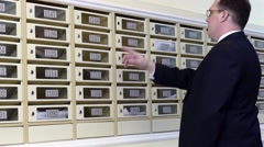 Apartment Concierge: Man checking on his mailbox Stock Footage