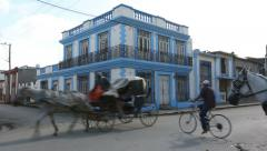 Cuba, Cardeans street scene with cyclists and horse cart Stock Footage
