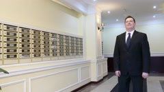 Apartment Concierge: Man on mailboxes background Stock Footage