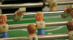Close of warn out foosball players Stock Footage