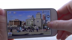 4K Woman take photo mobile phone Placa Espanya Barcelona traffic street car pass Stock Footage