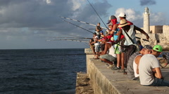 Cuba, Havana, Angler in the Malecon at sunset - stock footage