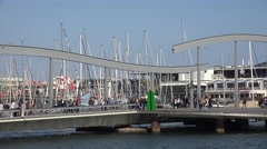 4K Crowded bridge Port Vell tourist people walk promenade Barcelona old bay day  Stock Footage